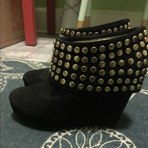 Black suede booties with gold detail